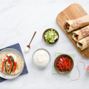 Aubergine, red pepper pita wraps with tahini yoghurt sauce